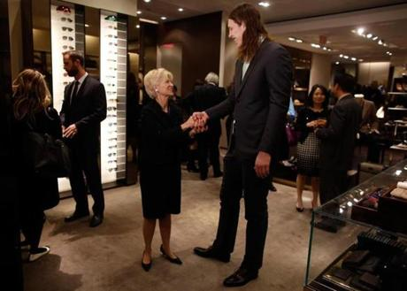 Children's Hospital president and CEO Sandra Fenwick greeted Celtic Kelly Olynyk.